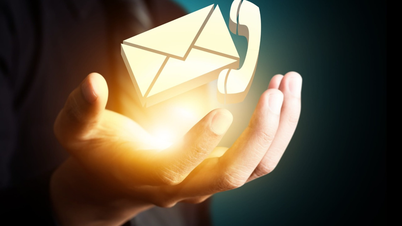 hands holding email and phone icon light