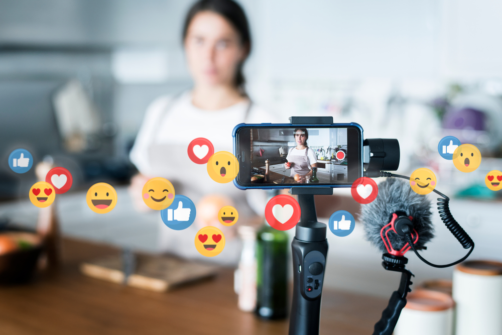 emojis while girl is recording cooking show using phone